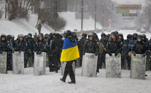 Ukrainian protester in front of riot police